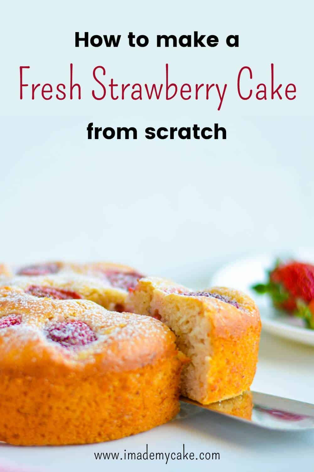 Fresh Strawberry Tea Time Cake with red strawberries on a white plate behind.