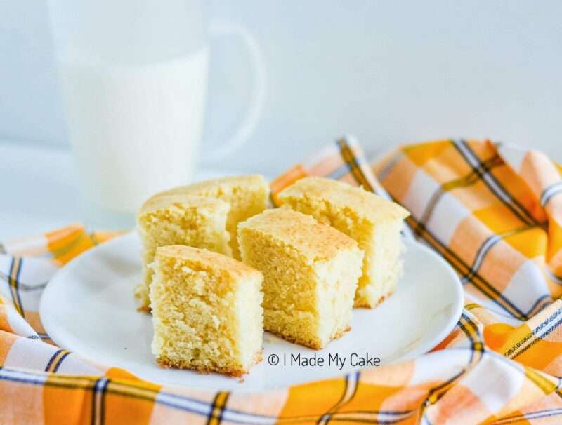 hot milk cake slices with a glass of milk
