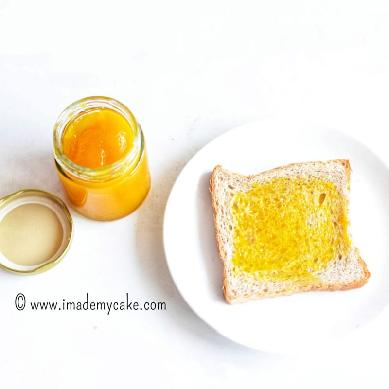homemade mango jam on a slice of white bread