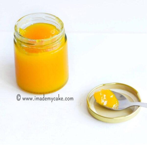 a spoon of mango jam from the jar